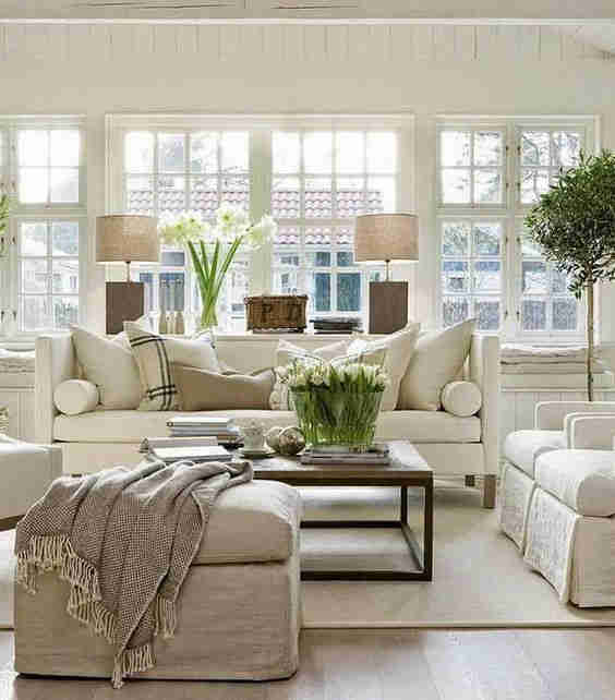 Traditional living area with cream sofas, timber coffee table and textured soft furnishings.