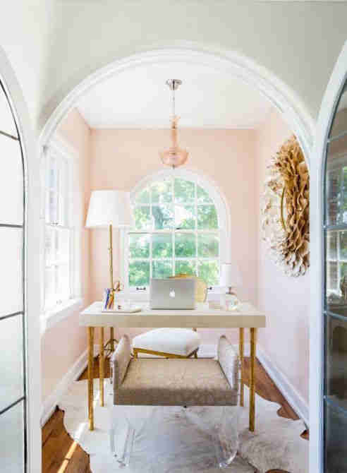 Light-filled study with salmon pink walls