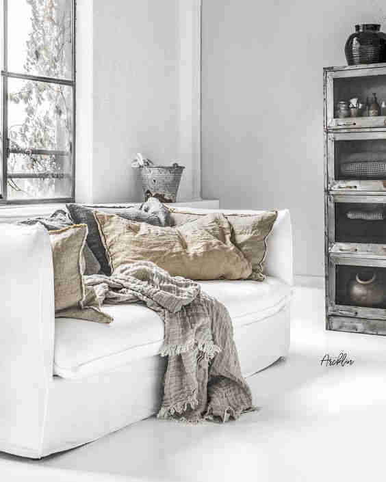 White linen sofa with natural linen cushions
