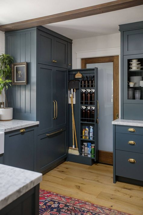 Beautiful blue timber kitchen with a wealth of storage options.