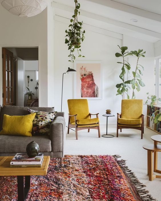 Stylish, neutral living area with mustard and raspberry accent colours